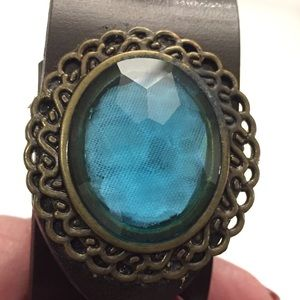 "Other - Leather bracelet  blue oval jewel. New. 7"" wrist"